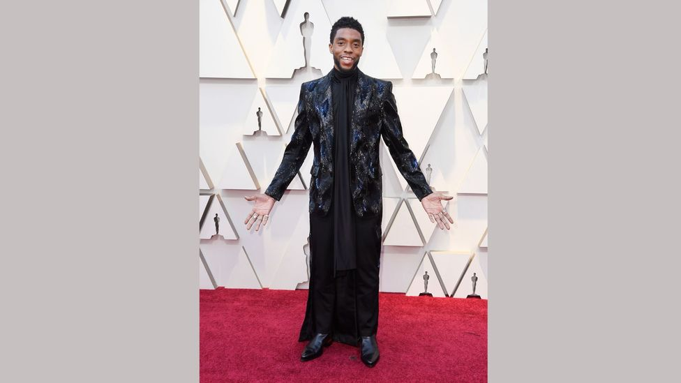 At the 2019 Oscars, actor Chadwick Boseman wore a heavily embellished tuxedo with long train by Givenchy haute couture (Credit: Getty Images)