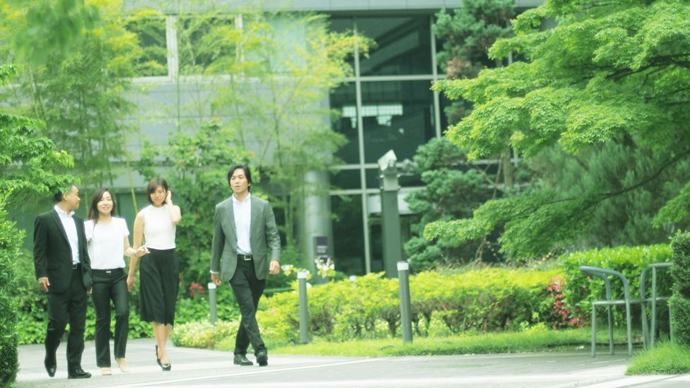 Colleagues on a walk in Japan. A microbreak can consist of just a few minutes away from your desk (Credit: Getty Images)