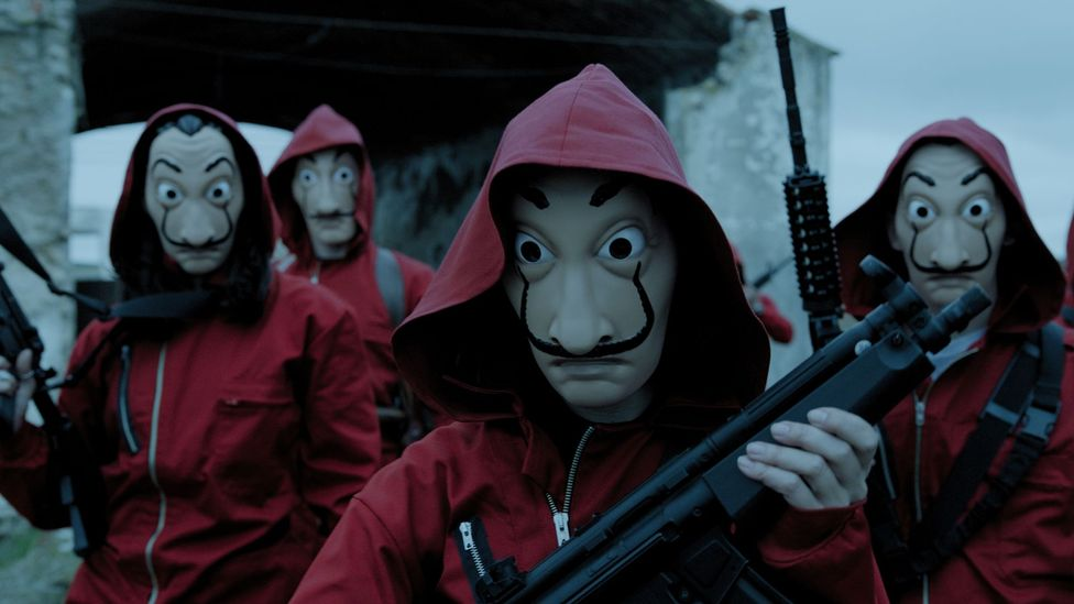 The Dalí masks the criminals wear look simultaneously creepy and cool (Credit: Netflix)