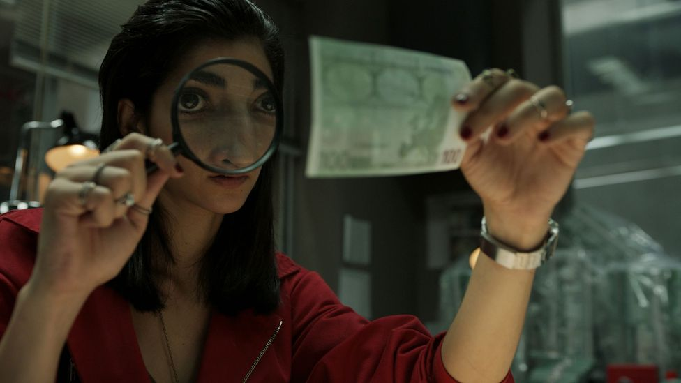 The team of eight criminals are holding hostages at the Royal Mint of Spain, printing billions of Euros (Credit: Netflix)
