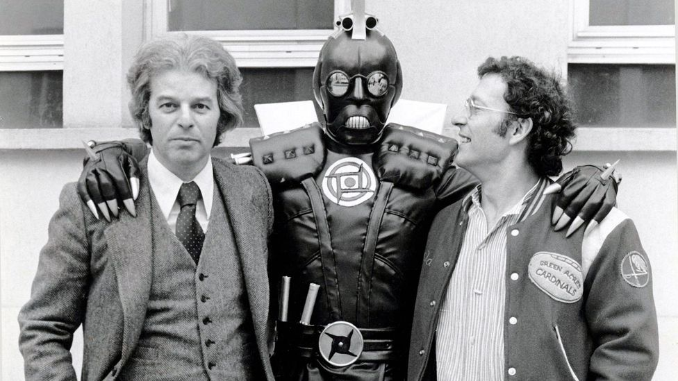 Acclaimed French comic artist Jean Giraud, pictured with Jodorowsky and an alien character in the early 1970s, broke the film down into 3000 drawings (Credit: Alamy)