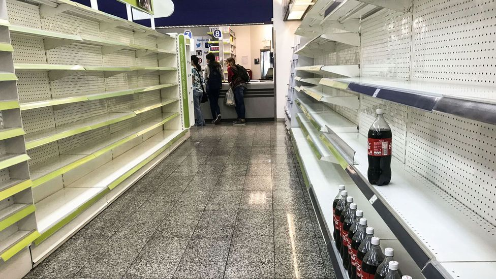 Political instability and skyrocketing inflation have led to empty shelves in shops in the capital of Venezuela (Credit: Getty Images)