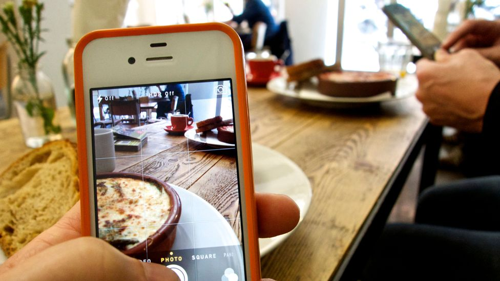Thanks to social media influencers and a host of foodie bloggers, food has become a clickable status symbol (Credit: Getty Images)