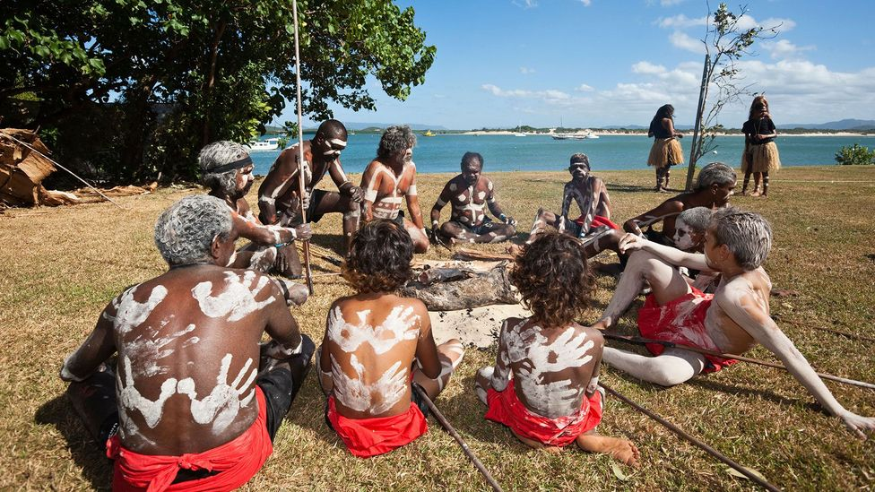 The language spoken by Guugu Yimithirr people, who are pictured here, is just one of many Aboriginal tongues that are now endangered (Credit: Getty)