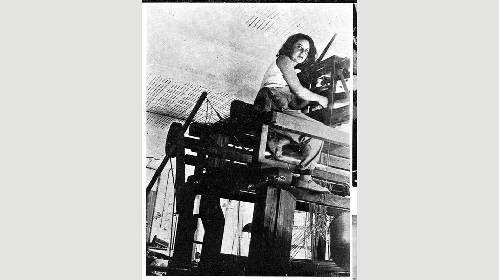 Textiles designer Otti Berger, seen here working at her high loom, came to the UK in the late 1930s (Credit: Yamawaki Iwao & Michiko Archives)