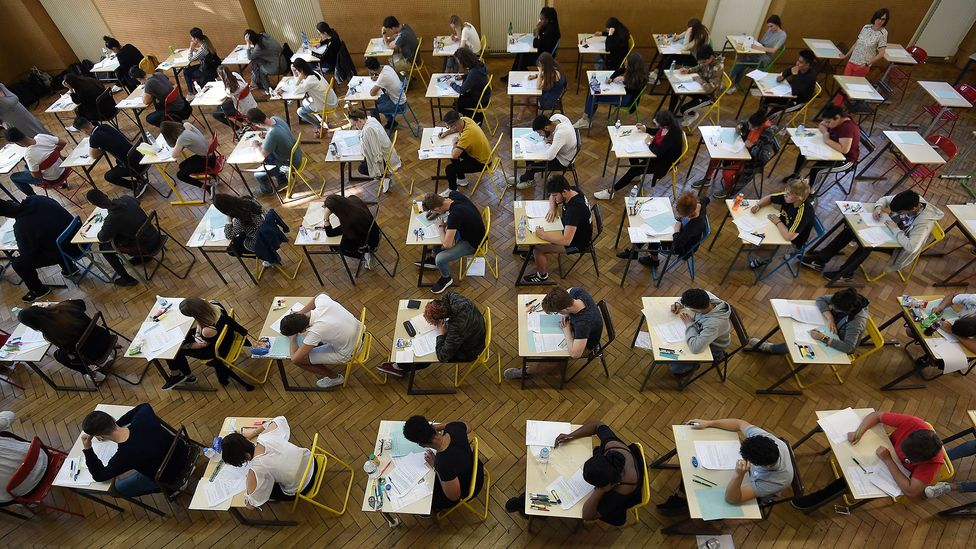 Essay mills have become more popular worldwide, as has university exam fraud. Pictured here are French high school students sitting an exam in 2018 (Credit: Getty Images)