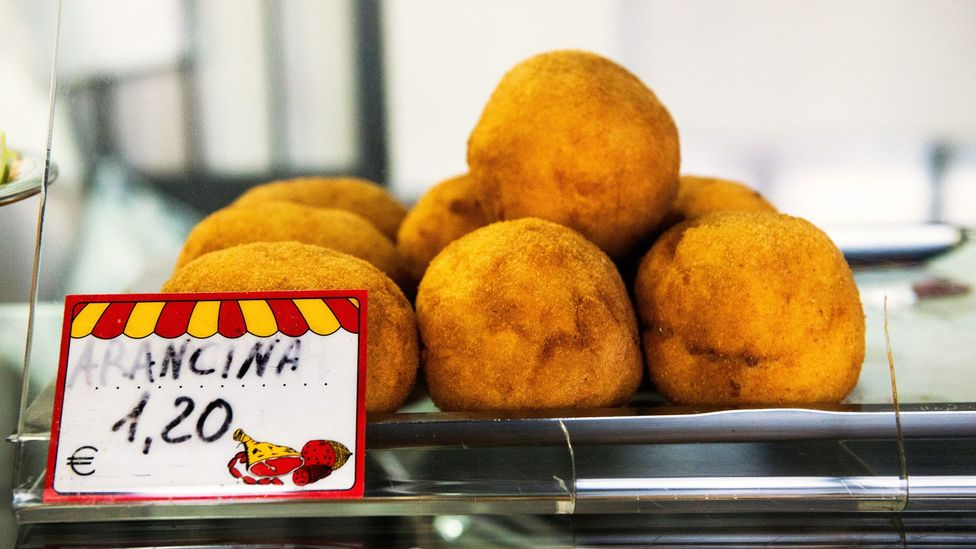 In Palermo and western Sicily they're known as 'arancina', the feminine noun, while Catania and eastern Sicily use the masculine noun, 'arancino' (Credit: Boaz Rottem/Alamy)