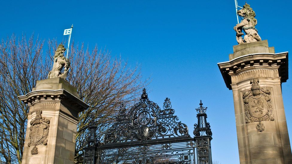 The gateway at the Palace of Holyroodhouse in Edinburgh, Scotland, is guarded on one side by a stone unicorn (Credit: doughoughton/Alamy)