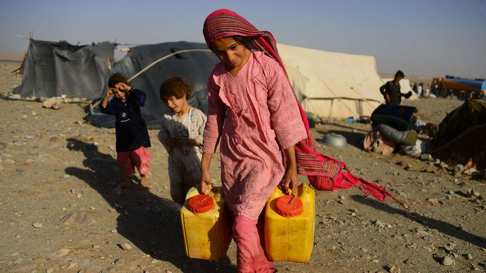 A girl carries water in the midst of the worst drought in living memory in Afghanistan, the type of event experts agree we are seeing more of due to climate change (Credit: Getty)