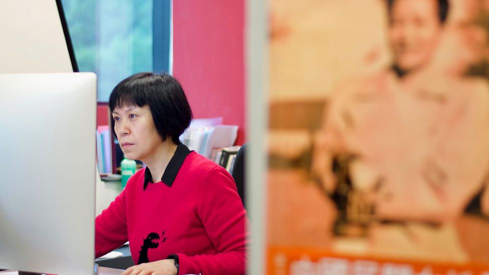 Filmmaker Louisa Wei edits her new movie – in the foreground is a poster of Esther Eng (Credit: Harriet Constable)