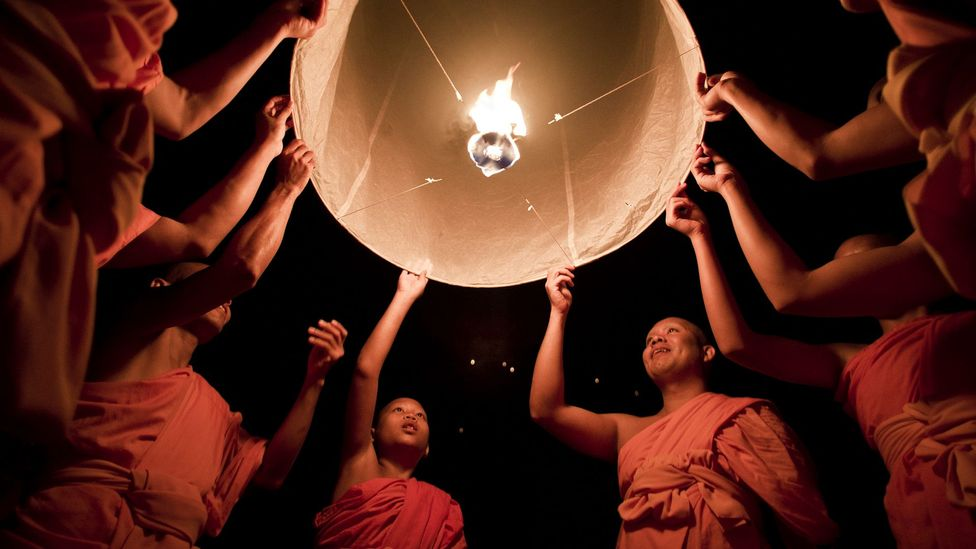 Buddhist monks launch a sky lantern during the Yee Peng Festival in Chiang Mai. The ritual symbolises the release of kindness and goodwill (Credit: Getty)