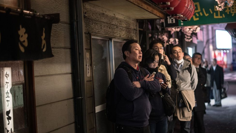 "Customers in Tokyo queueing for a popular restaurant. Unpleasant, unavoidable situations like these warrant a ""shou ga nai"" (Credit: Getty Images)"