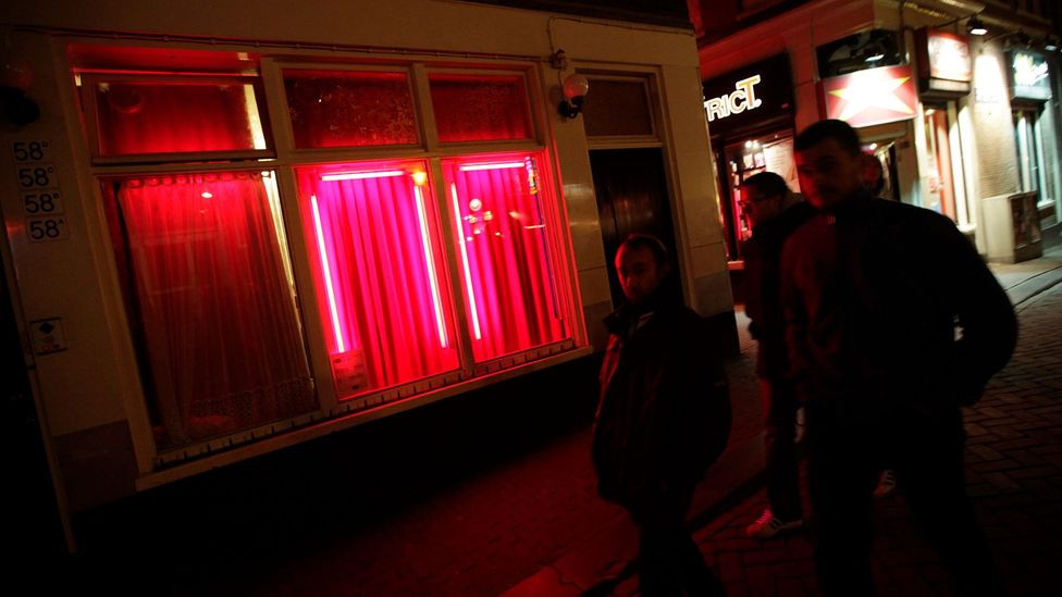 Amsterdam's famed Red Light District - a cultural icon for the city and symbol of sexual liberation for some (Credit: Getty Images)