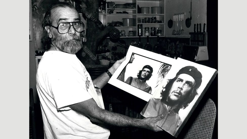 Alberto Korda is pictured with the uncropped and cropped versions of his photograph of Che Guevera (Credit: Alamy)
