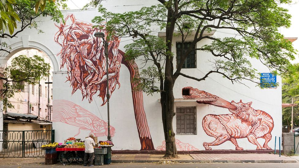 A mural in India's first designated public art district, the Lodhi Colony of New Delhi, uses plant motifs (Credit: Getty)