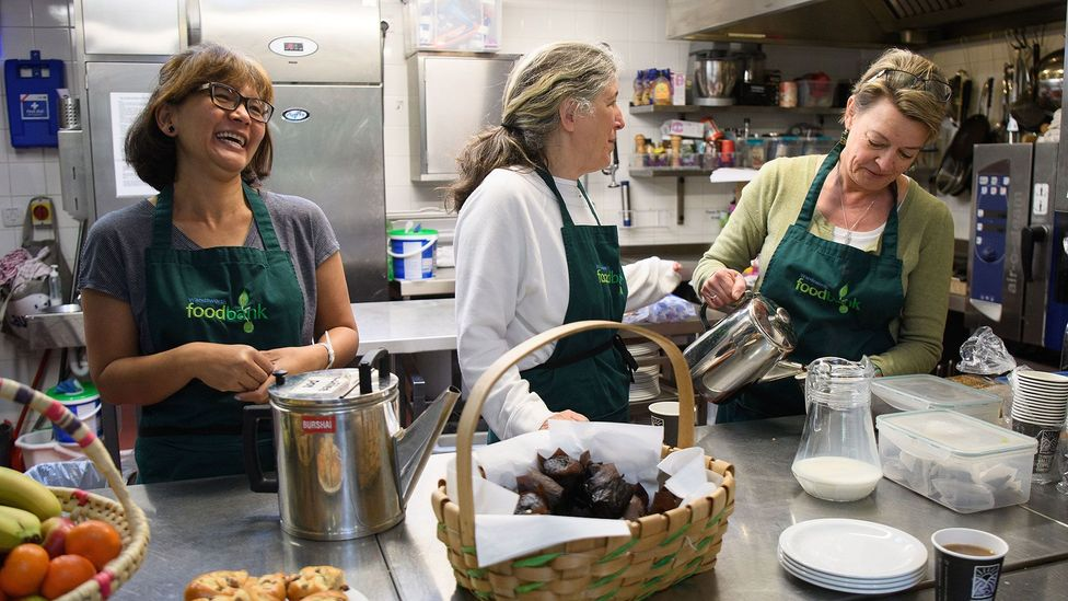 Volunteers prepare food for the needy at a London charity (Credit: Getty Images)