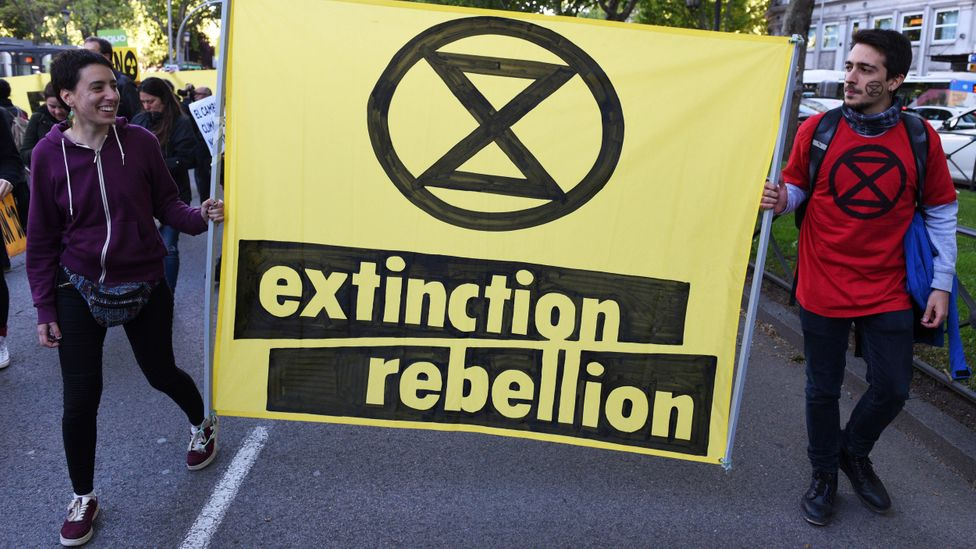 "Extinction Rebellion wants governments to ""tell the truth"" about the scale of the climate crisis and enact laws to cut carbon emissions to net zero by 2025 (Credit: Getty Images)"