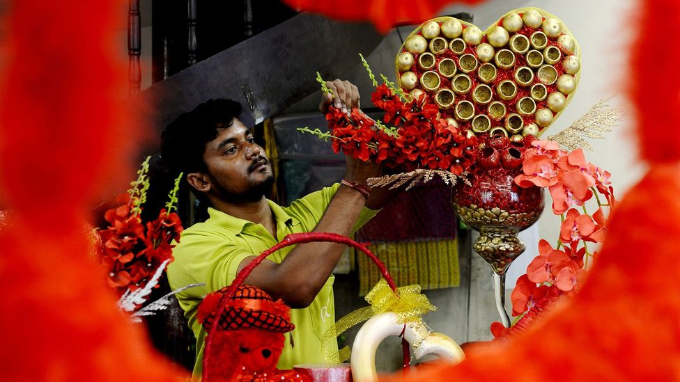 A florist in India preps a display earlier this year for Valentine's Day. Florists are highly trained, and their artistry is a factor that deteremines price (Credit: Getty Images)