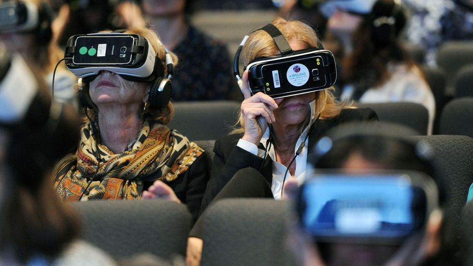 Attendees wear VR headsets at An Evening with Lynette Wallworth in 2016 (Credit: Getty Images)