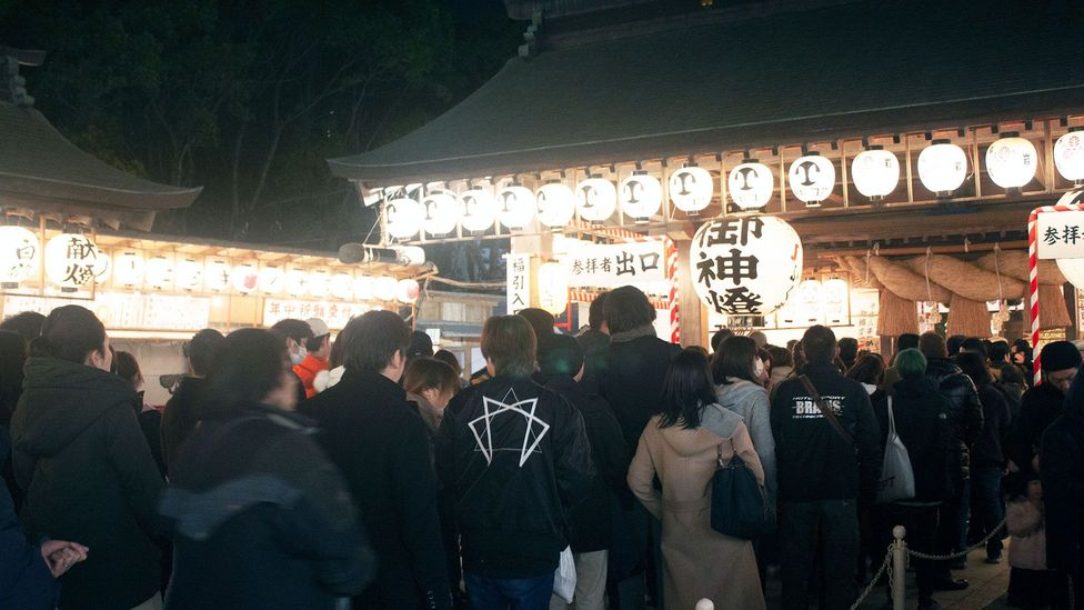 Locals in Fukuoka attend a festival at the Toka Ebisu shrine and pray for good luck and success in business in the year to come (Credit: Edd Gent)