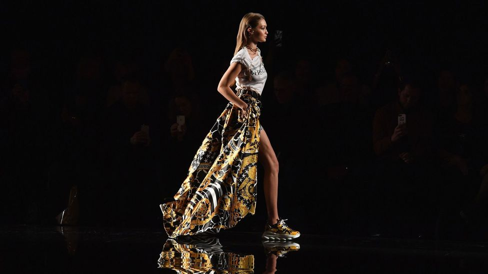 Model Gigi Hadid sports clumpy trainers on the catwalk at the Versace Cruise 2019 show (Credit: Getty Images)
