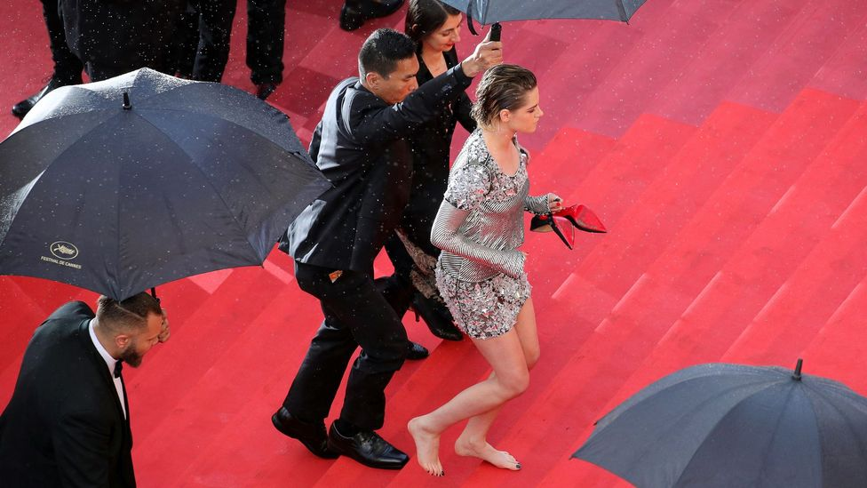 Kristen Stewart walked the Cannes red carpet in bare feet in 2018 as a protest against the film festival's high-heel rule for women (Credit: Getty Images)