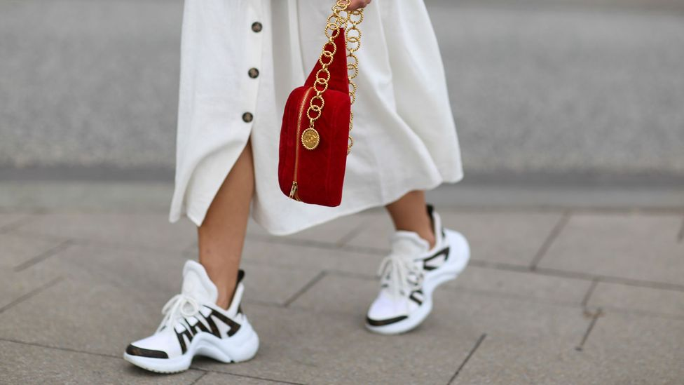 Chunky trainers such as these by Louis Vuitton have largely taken over from heels in fashion circles (Credit: Getty Images)