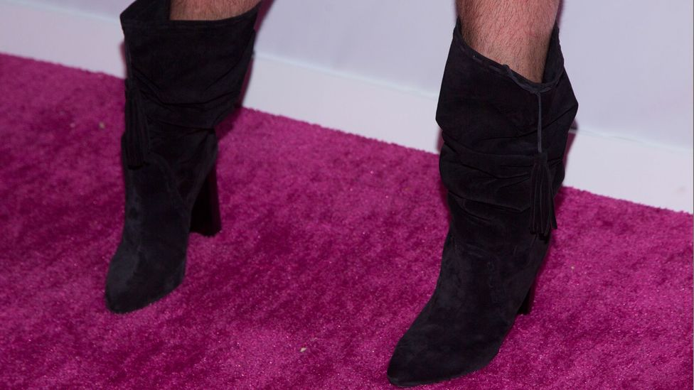 High-heeled boots and shoes have become increasingly available in men's sizes – as seen here on TV presenter Jonathan Van Ness (Credit: Getty Images)