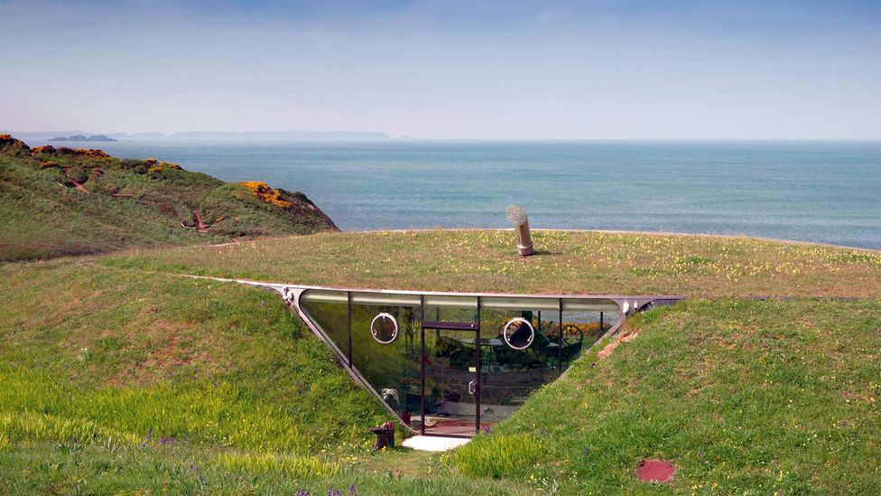 Inside the hill, an ellipse-shaped glass frontage opens to the sea (Credit: Architecture UK/Alamy)
