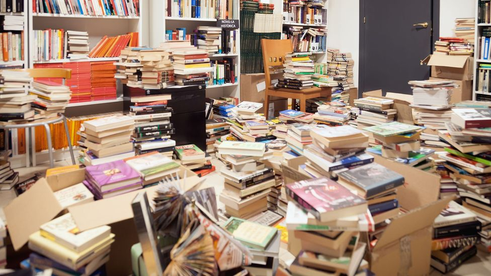 Once read most books will sit unused on shelves, or even the floor, for years, yet many of us are reluctant to discard them (Credit: Getty Images)