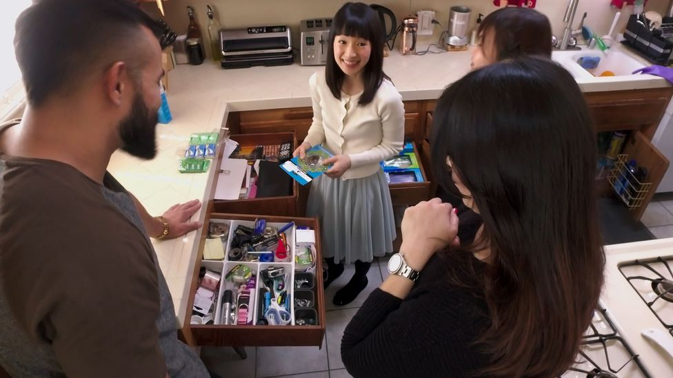 Marie Kondo's approach to organisation, such as discarding books and placing smaller boxes inside drawers, has been met with horror by some householders (Credit: Netflix)