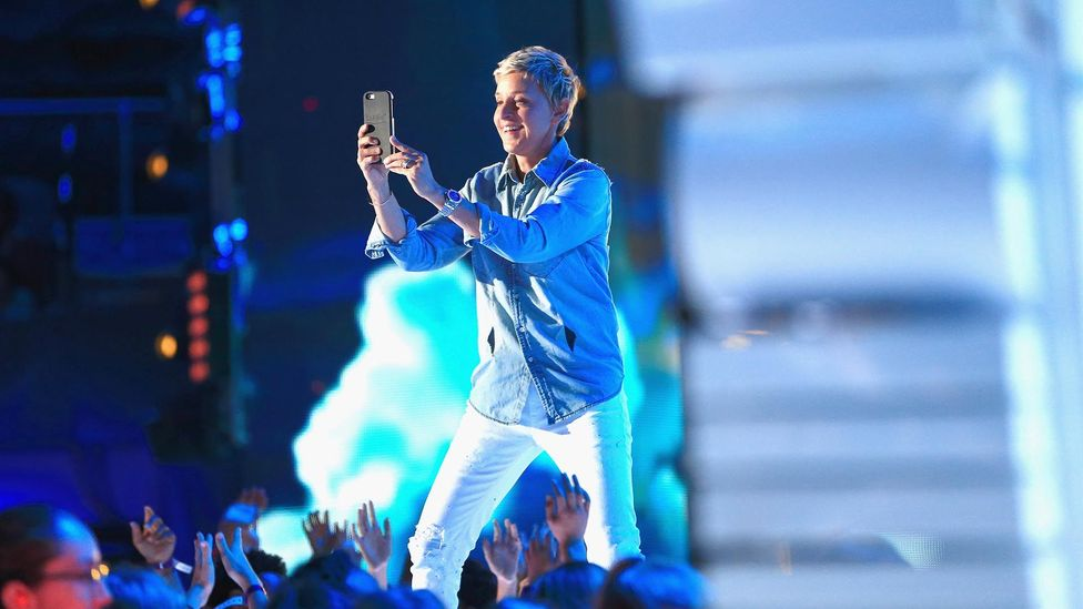 The famous presenter and CEO often opts for dance-friendly sneakers and bright button-downs (Credit: Getty Images)