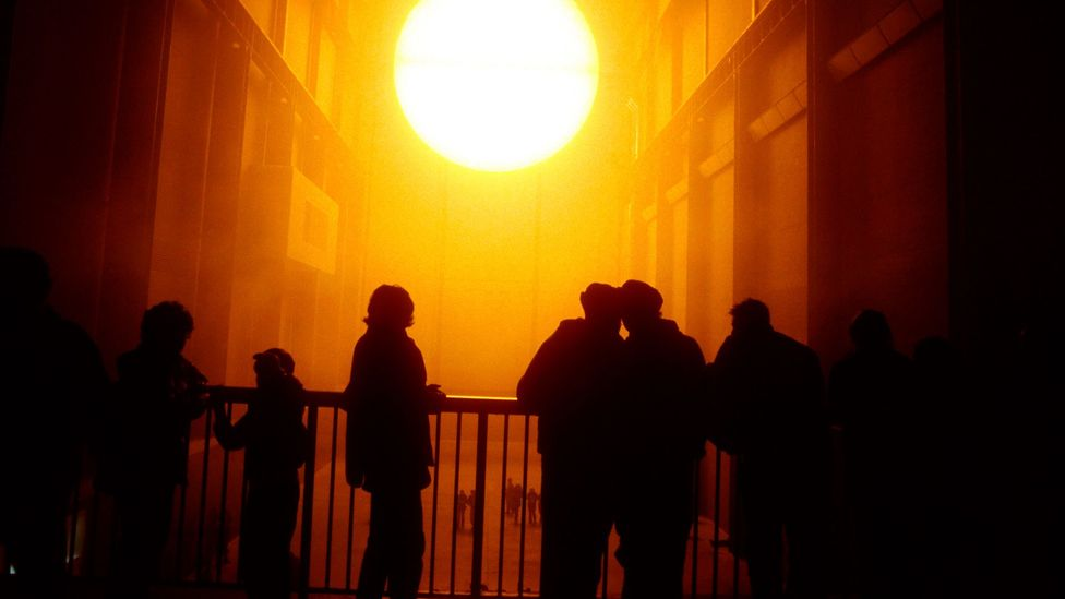 Olafur Eliasson's the Weather Project in the Tate Modern prompted meetings, celebrations, relaxation, noisy acts of protest, and silent contemplation (Credit: Getty Images)