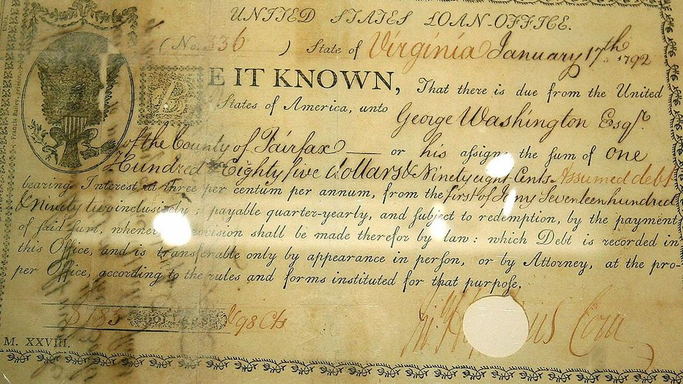 This vintage bond signed by former US president George Washington in 1792 contains the first use of the dollar sign on an American financial document (Credit: Getty Images)