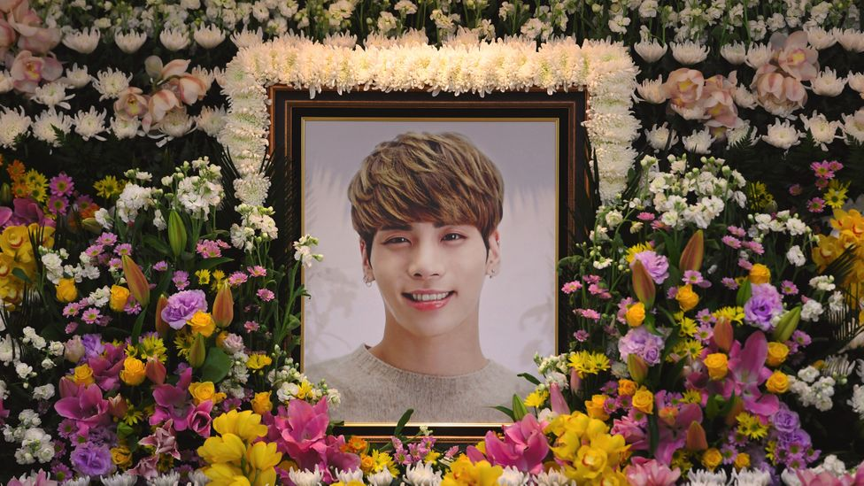 Tributes to Kim Jong-Hyun, the 27-year-old lead singer of SHINee (Credit: Getty Images)