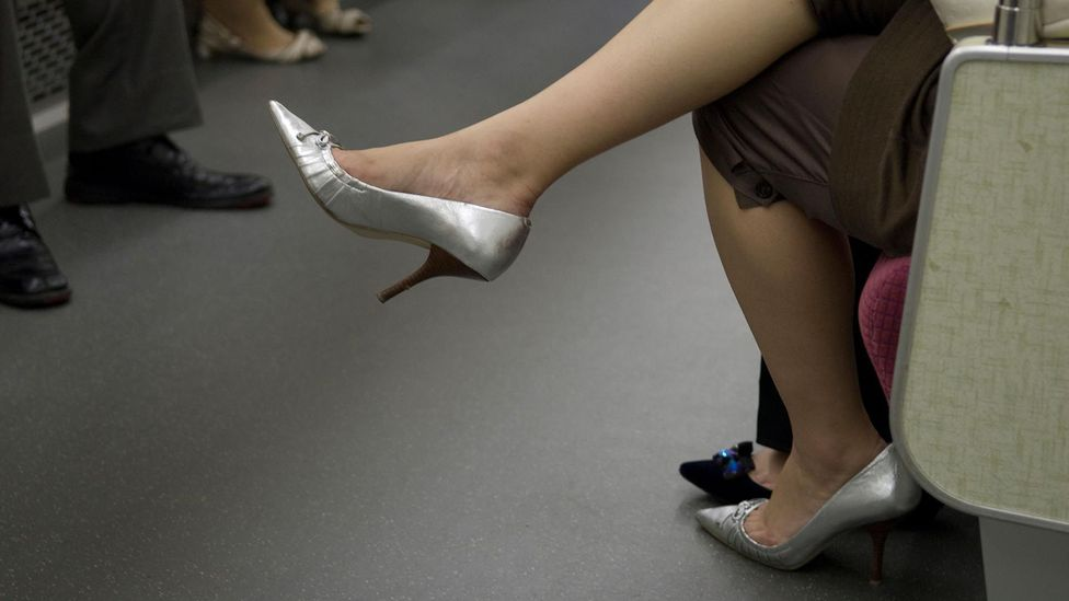 High heels, seen here on a Tokyo train, have long been a staple for Japanese women in the office, but a recent social media campaign is pushing back (Credit: Alamy Stock Photo)