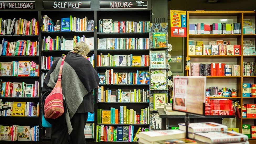 Book shops are full of volumes offering everlasting happiness, but how many of their promises are realistic? (Credit: Alamy)
