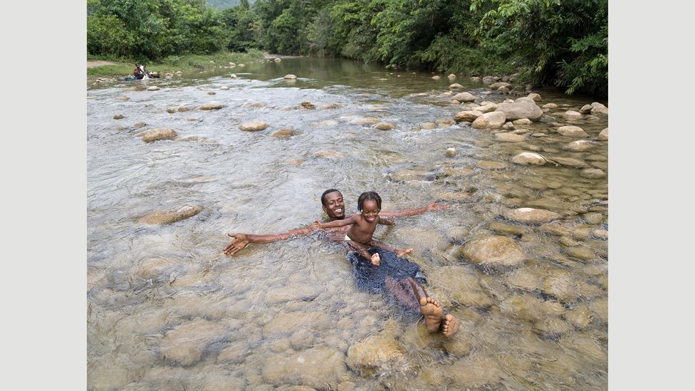 Living near the river in Haiti, one of Jhonny Labossière's favourite activities with his daughter is playing in the water (Credit: Gabriele Galimberti/INSTITUTE)