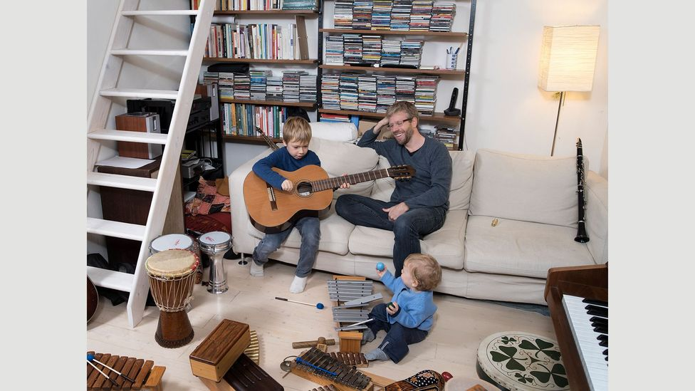 A musician living in Florence, Italy, Davide Woods's musical instruments have become playthings for his children Noah and Ian (Credit: Gabriele Galimberti/INSTITUTE)