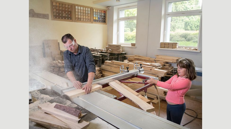 Eight-year-old Renate loves to help her father Eriks Oficier, a carpenter in Kuldiga, Latvia, and comes in whenever she doesn't have school (Credit: Gabriele Galimberti/INSTITUTE)