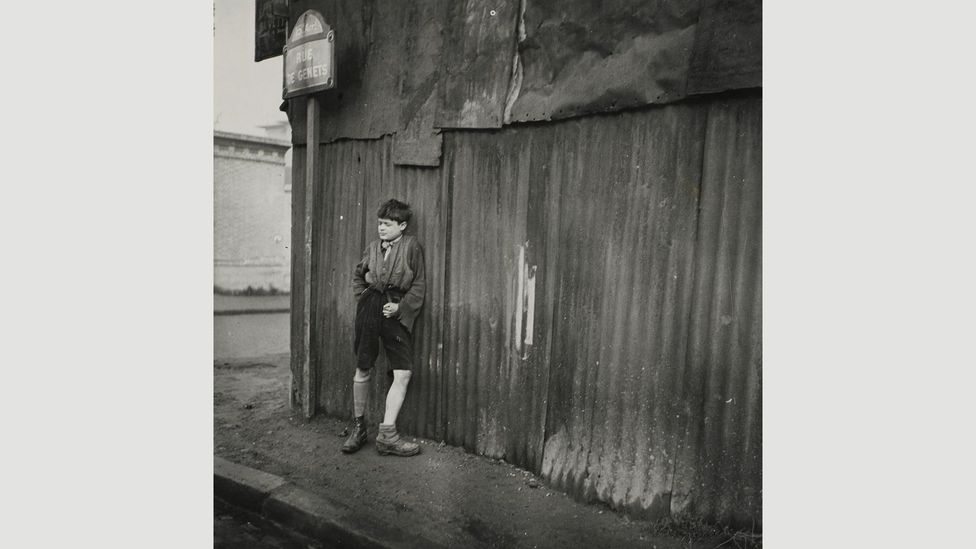 Maar expressed her left-wing ideology in her street photography, such as Sans titre, 1933, a portrait of a boy leaning against a corrugated iron wall (Credit: Centre Pompidou)