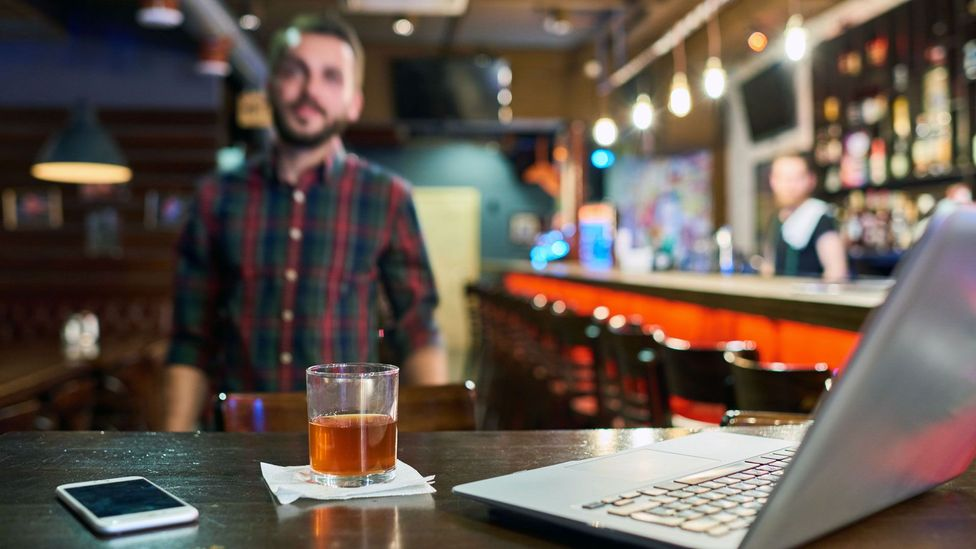 To identify pre-burnout, watch out for creeping bad habits, such as drinking more and relying on sugar to get you through the day (Credit: Alamy)