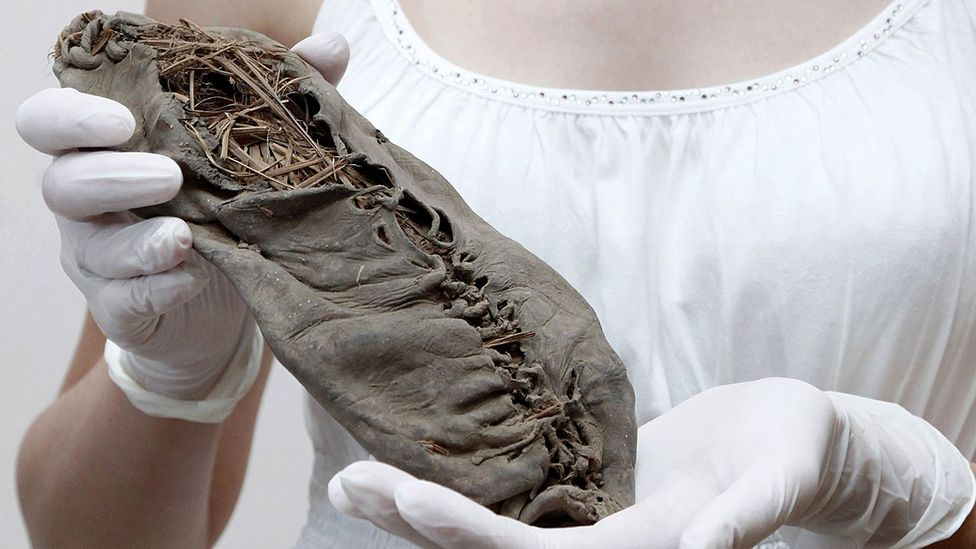 A 5,500-year moccasin said to be the world's oldest leather shoe (Credit: Getty Images)