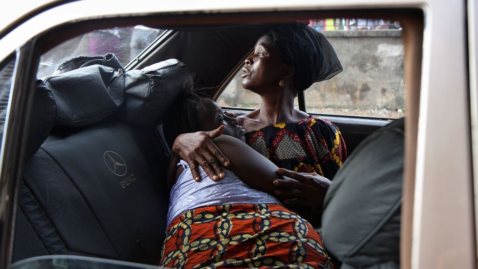 Jemelleh Saccoh of Sierra Leone, here in her aunt's arms, turned down an elective C-section; she later had an emergency C-section and died of complications (Credit: Getty Images)