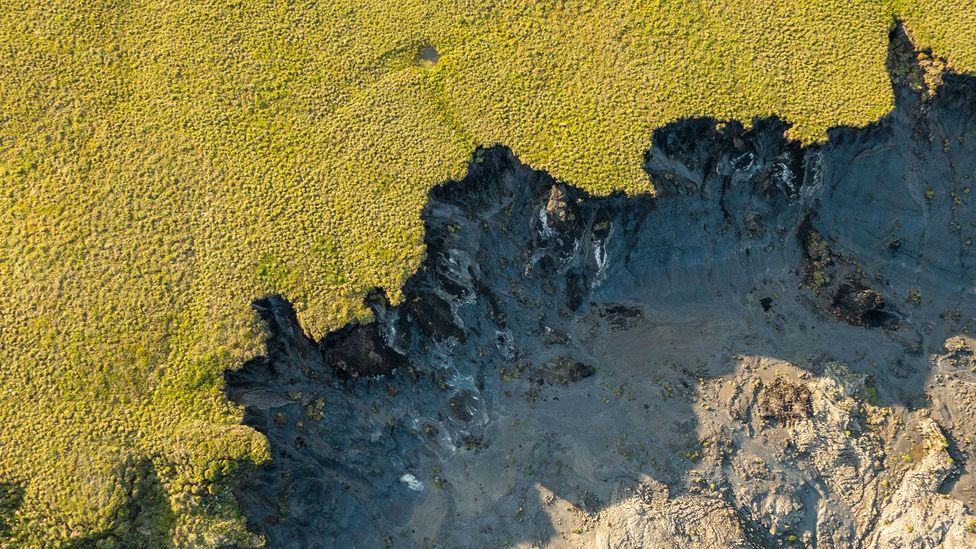 The melting permafrost is creating huge sinkholes (Credit: Alamy)