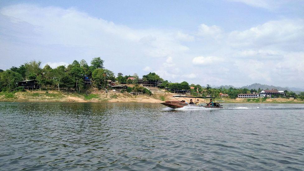 Boat on the Sangkalia River near Sangkhlaburi, Thailand