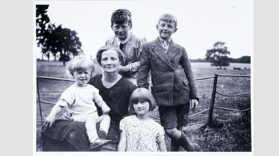 Clarke – pictured (top) with his mother and siblings – was born in Somerset in 1917; he never lost his West Country vowels (Credit: Getty)