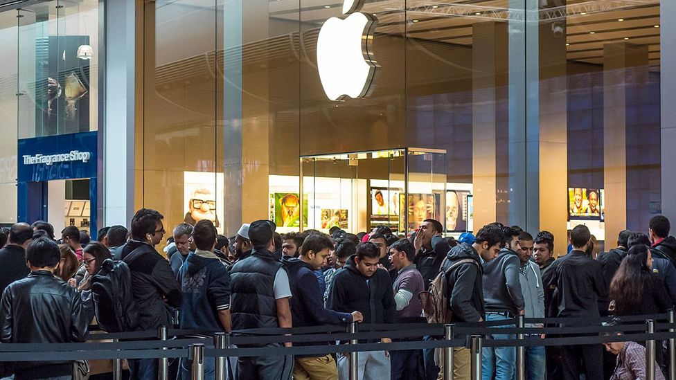 Apple fans camp out ahead of new product launches - numbered wristbands mark their place in line and some are allowed to leave for up to one hour for meal breaks (Credit: Alamy)