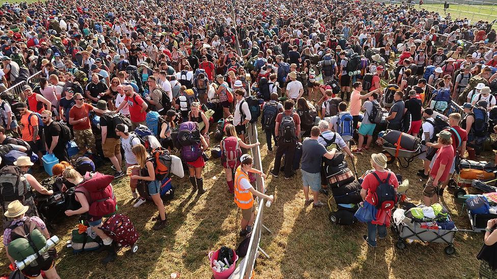 Festival go-ers for Glastonbury wait patiently to access the grounds (Credit: Getty Images)