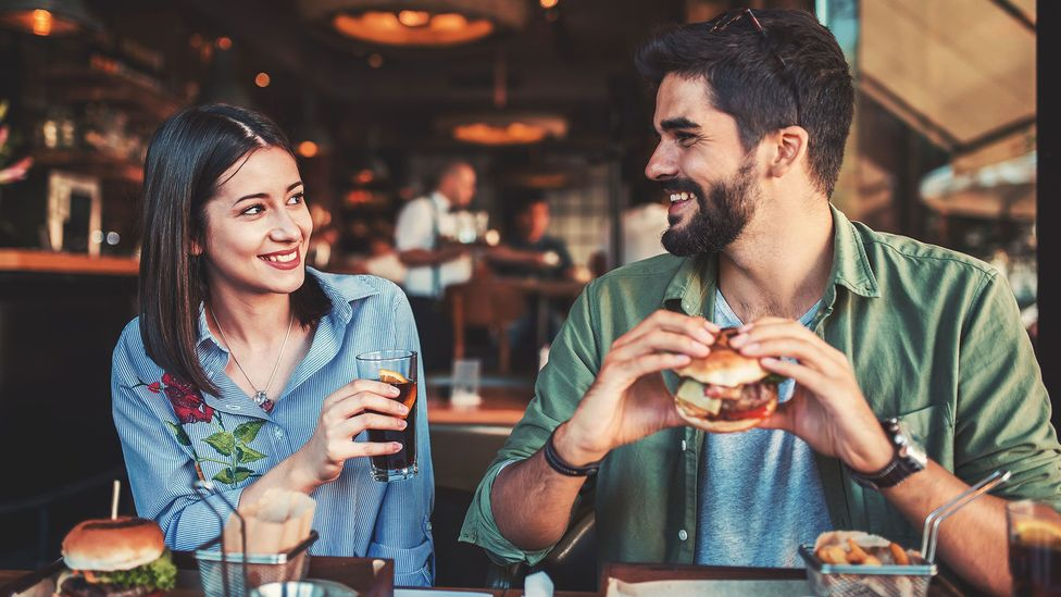 For around one in 20 heterosexual people, simply buying a meal for someone of the opposite sex is considered to be a betrayal (Credit: Getty images)